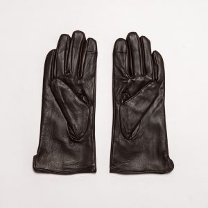 Image displays a flat lay of dark brown leather gloves for women. The gloves are positioned palm up against a grey background.