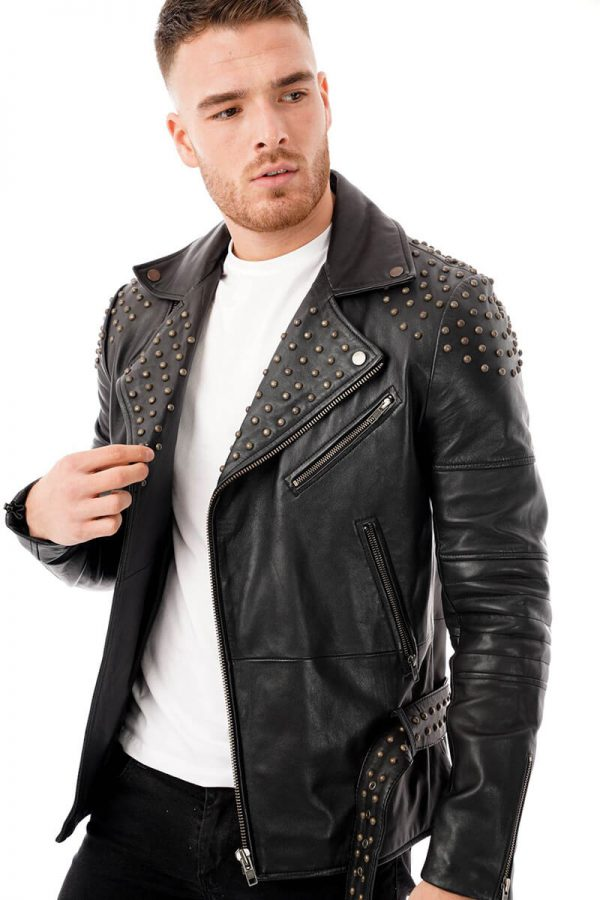This image shows a Barneys Originals, men's studded leather jacket being worn by our model. In this picture, the model is wearing the jacket open.