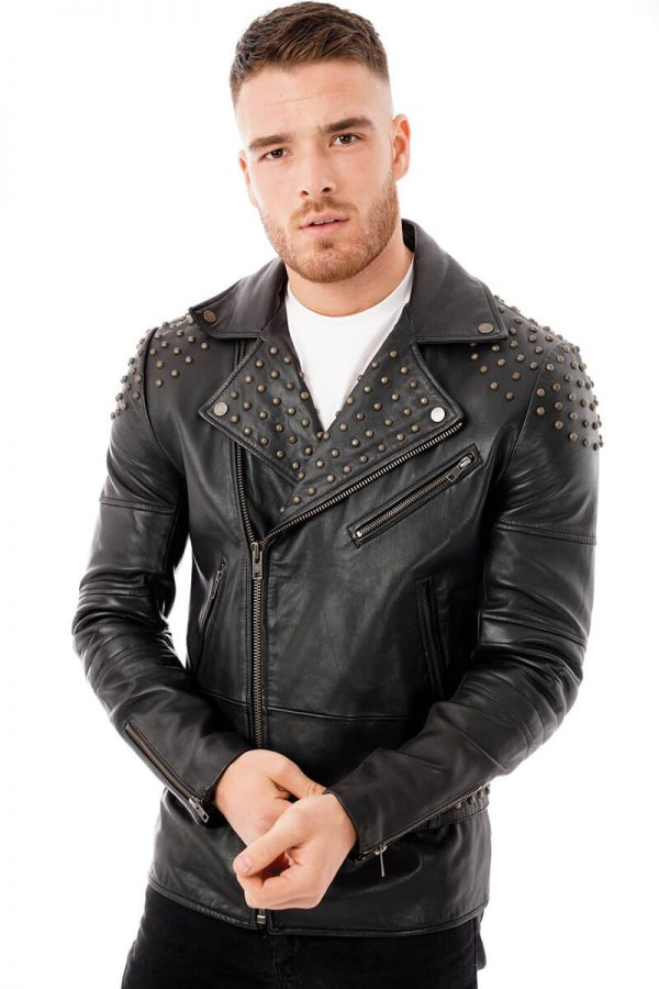 This image shows a Barneys Originals, men's studded leather jacket being worn by our model. In this image the model has zipped the jacket up.