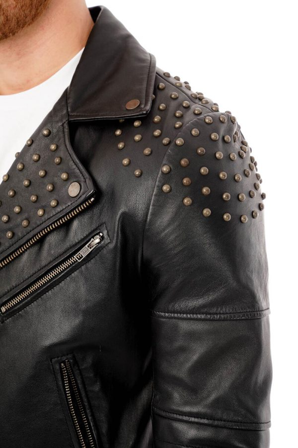 This image shows a Barneys Originals, men's studded leather jacket being worn by our model. This image focuses on the studded shoulder and lapel