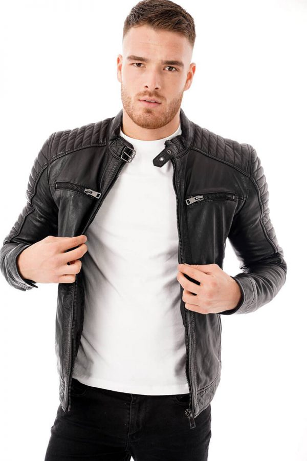 This image shows a Barneys Originals men's black biker jacket being worn by our model. In this picture the model is wearing the jacket open.