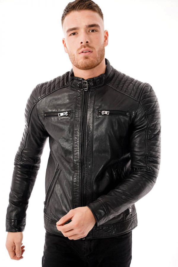 This image shows a Barneys Originals men's black biker jacket being worn by our model. In this picture the model has zipped the jacket up to the top.