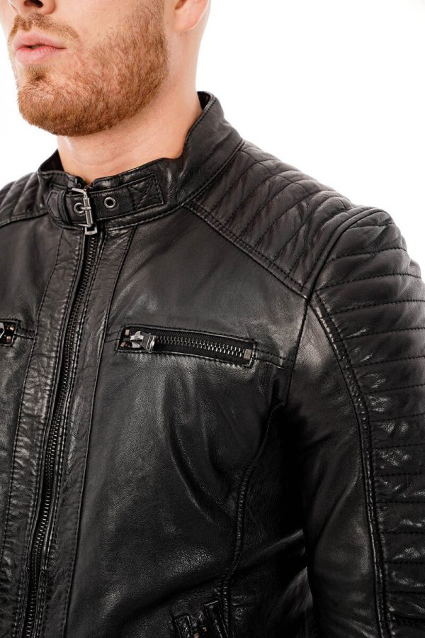 This image shows a Barneys Originals men's black biker jacket being worn by our model. This picture focuses on the collar of the jacket