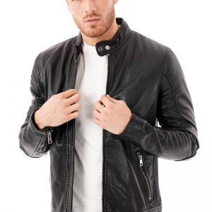 This image focuses on a Barneys Originals men's real leather black biker jacket with a tab neck. being worn by our model. In this picture the model is wearing the jacket open.