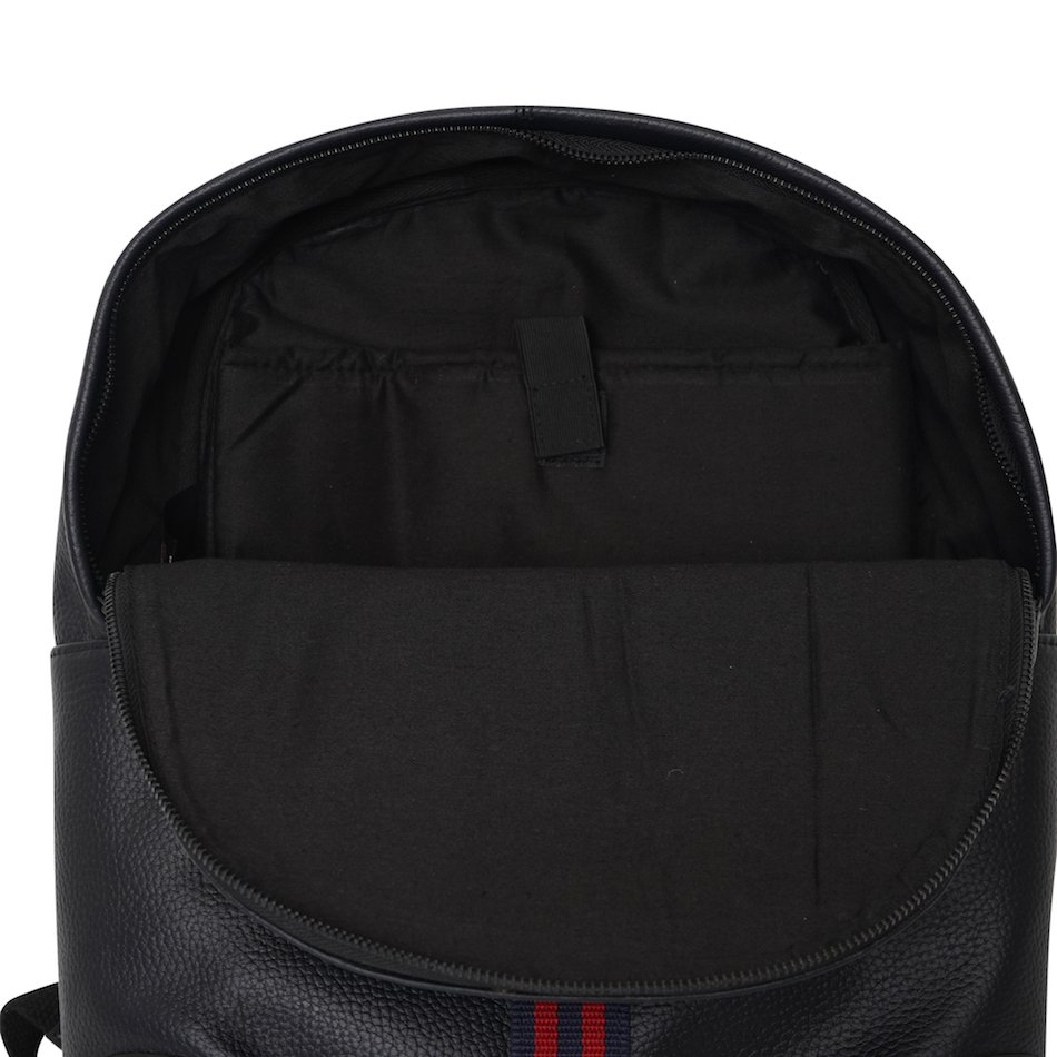 This image shows a Barneys Originals Real Leather Backpack with Red & Navy Stripe. This image focuses on the inside of the bag.