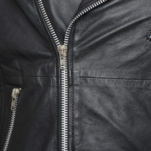 This image shows a Barneys Originals Men's Real Leather Biker Jacket With Padded Panels. The image focuses on the zip of the jacket.