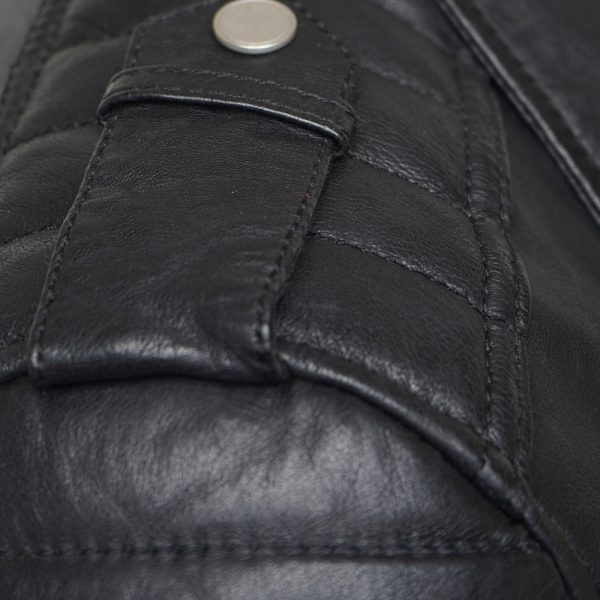 This image shows a Barneys Originals Men's Real Leather Biker Jacket With Padded Panels. The image focuses on the silver pop studs on the collar of the jacket.