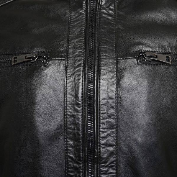 This image shows a Barneys Originals Men's Real Leather Black Biker Jacket With Ribbed Padded Detail. This image focuses on the black zip on the front of the jacket.