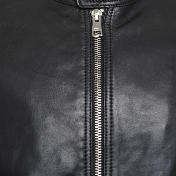 This image shows a Barneys Originals Men's Real Leather Biker Jacket with Tab Neck Collar. This image focuses on the zip on the jacket.