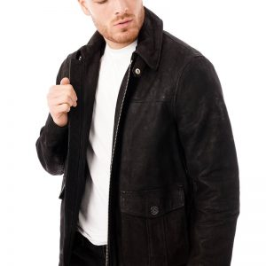 This image shows a Barneys Originals men's suede black jacket being worn by our model. In this picture he is wearing the jacket open.