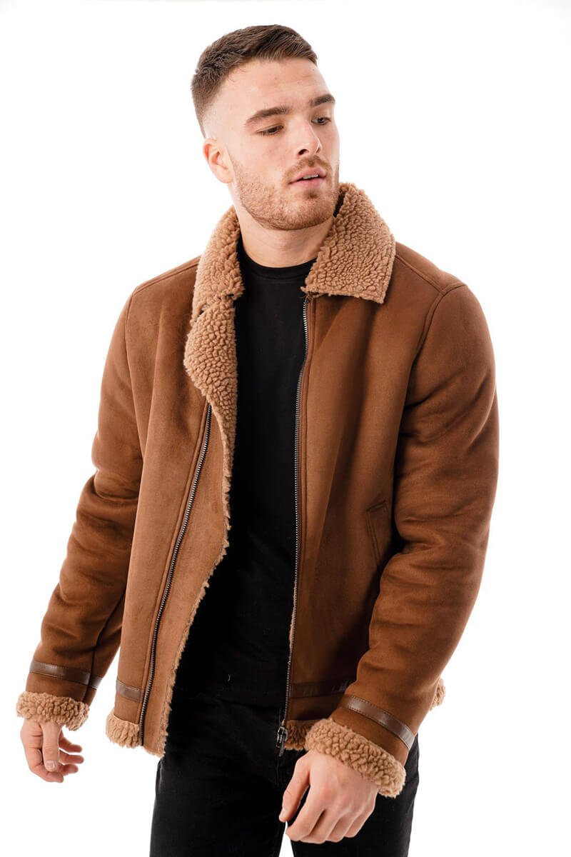 This image focuses on the barneys originals faux suede jacket being worn by our model. In this picture the model is wearing the jacket open.