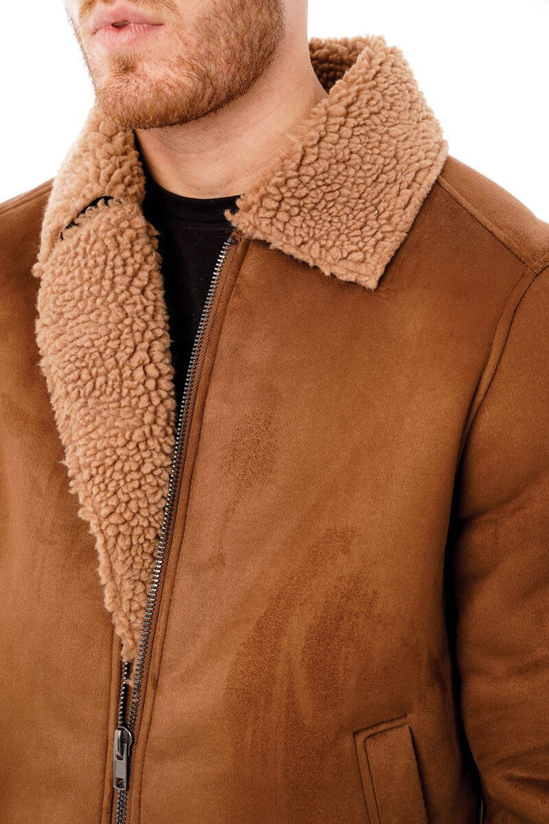 This image focuses on the barneys originals faux suede jacket being worn by our model. This image focuses on the lapel.
