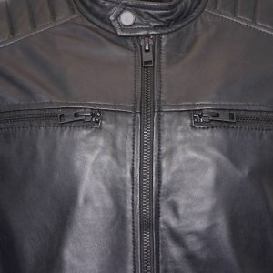 This image shows a Barneys Originals Men's Matte Black Real Leather Jacket. This picture focuses on the chest of the jacket.