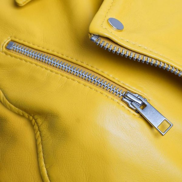 This jacket shows a Barneys Originals Women's Real Leather Yellow Biker Jacket with Waist Belt. This image focuses on the zip of the jacket.