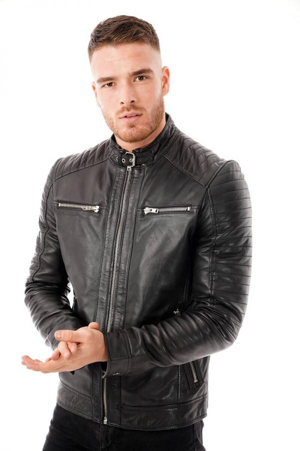 This image shows a Barneys Originals men's black leather jacket with a buckle collar being worn by our model. In this picture the jacket is zipped to the top.
