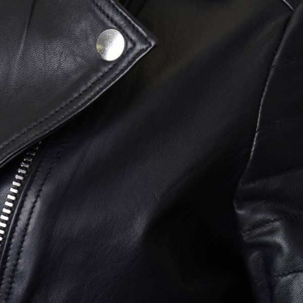 This image displays a close up cross section of the jacket, focusing on the lapel and silver pop stud.