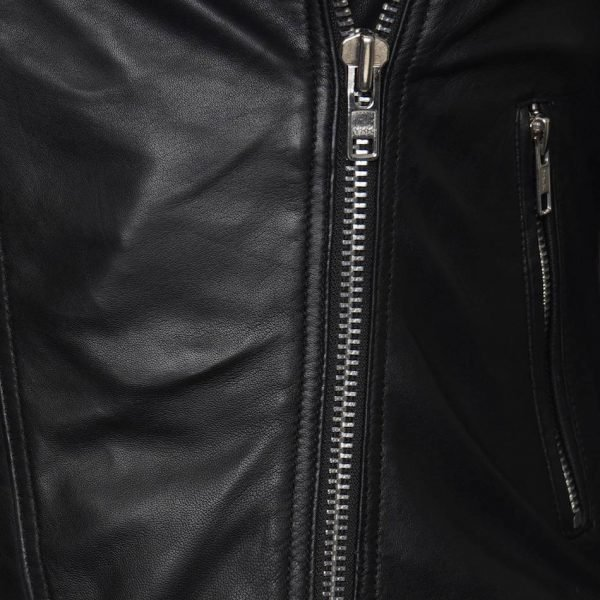 This image is the second close up shot of the jacket, giving you a closer look at the silver metal zip and smooth leather.