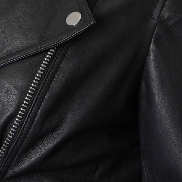 The image displays a close up section of the leather jacket, a shot taken just below the sholder which displays the silver pop stud on the right lapel.