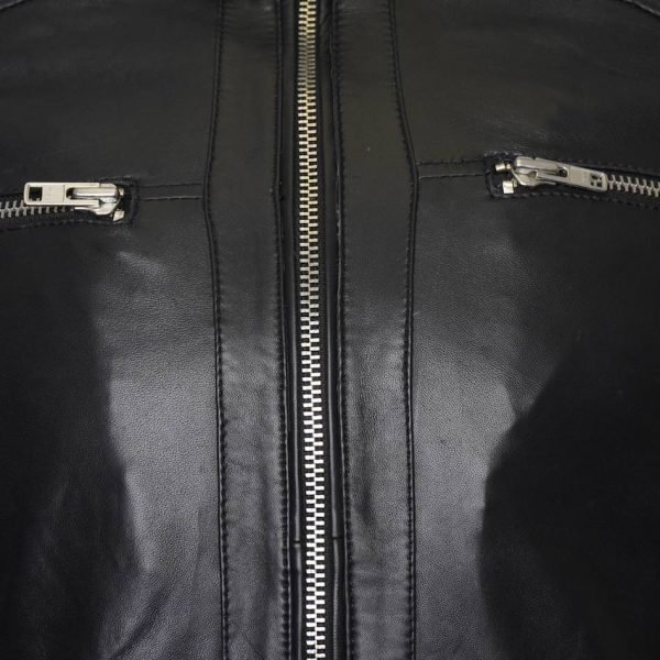 This image shows a Barneys Originals Men's Real Leather Biker Jacket with a Buckle Collar and Padded Detailing. This image focuses on the chest zips on the jacket.