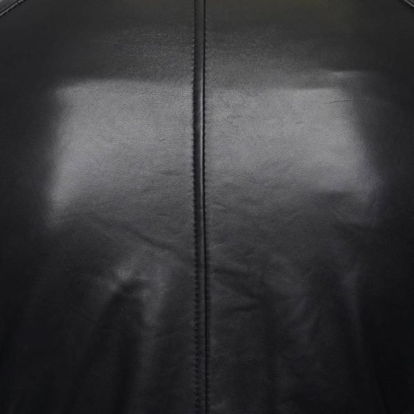 This image shows a Barneys Originals Men's Real Leather Biker Jacket with a Buckle Collar and Padded Detailing. This image focuses on the smooth leather texture on the back of the jacket.