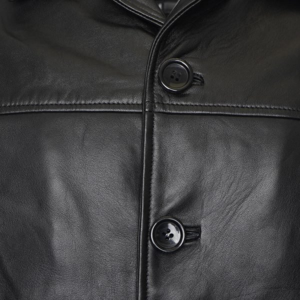 The image displays a close up shot of the jacket's buttons and you can see the smoothness of the leather.