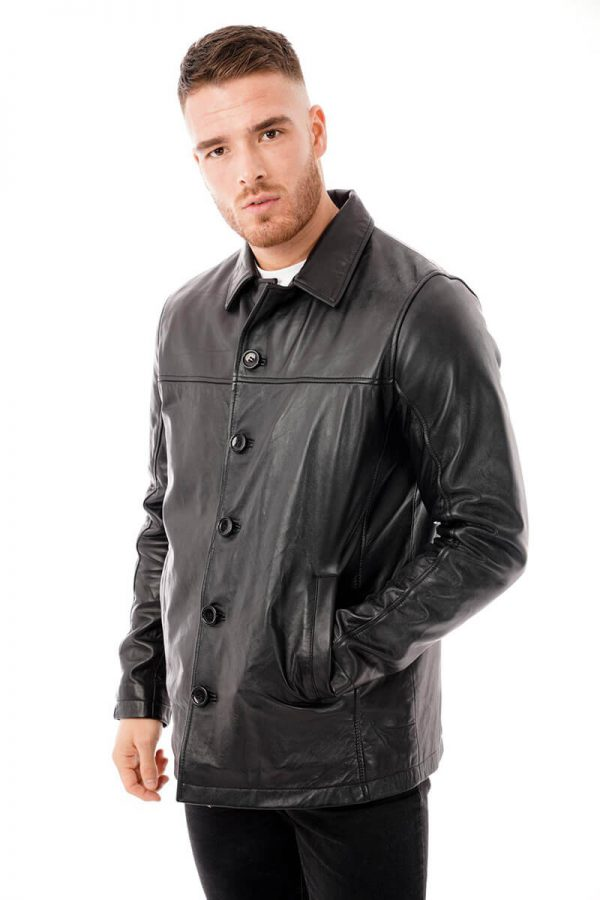 This image shows a Barneys Originals men's reefer jacket being worn by our model. In this photo, the model has buttoned the jacket to the top.