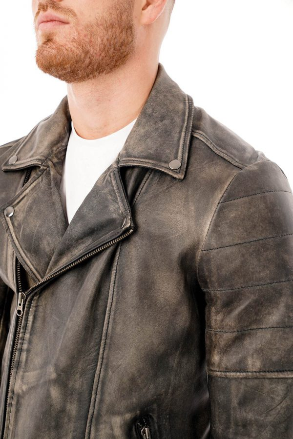 This image shows a man's Barneys Originals grey washed leather jacket being worn by our model. This image focuses on the collar and chest of the jacket.
