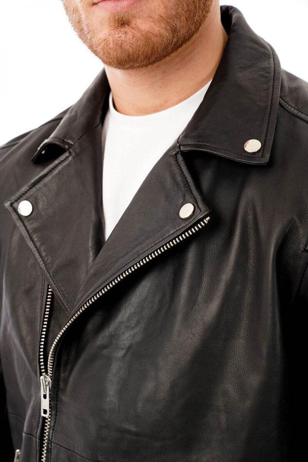 This image shows a Barneys Originals men's black leather jacket being worn by our model. This image focuses on the lapel and collar of the chest.