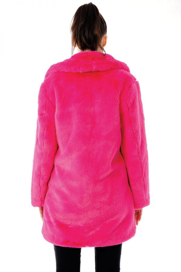 Image displays the pink faux fur coat worn by a model but this time shot from the back to give you an idea of what this jacket will look like from behind. This jacket is a real head turner, so you might want to check this one out! You can see that the collar is quite chunky and that the length of the jacket falls below the hips but does not go below the knees.