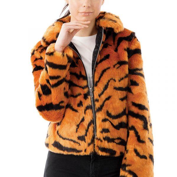 Size 8 model wears a size 8 tiger print faux fur jacket. The jacket is zipped halfway.