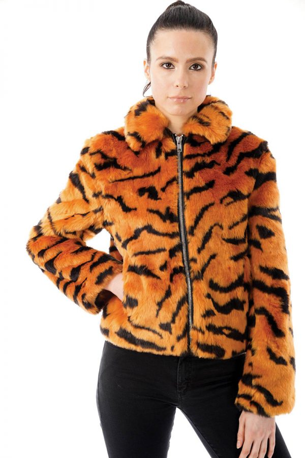 Image displays size 8 model wearing a size 8 tiger print faux fur jacket. The jacket has long sleeves and sits on the hips.