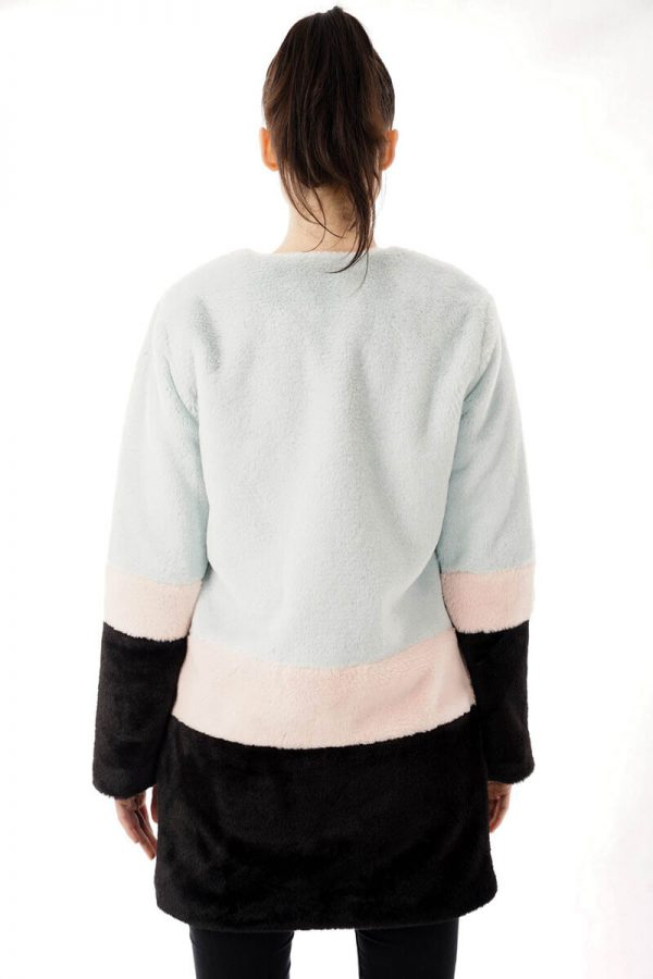 Image displays a model wearing the pastel faux fur coat from the back. The length of the jacket is visible and displays the jacket falling below the waist and about three inches abovethe knee.