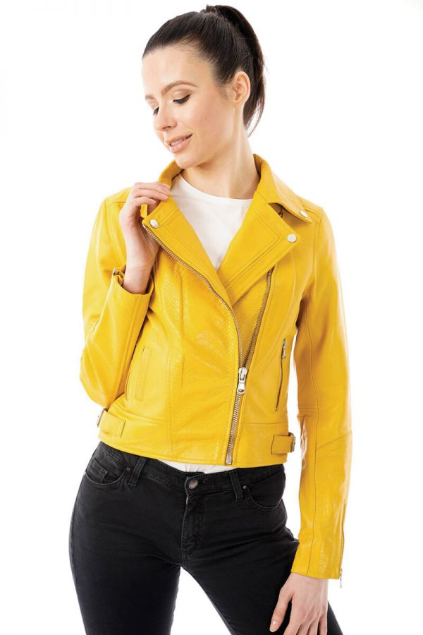 Image displays a size 8 model wearing the SHR 288 yellow biker jacket with snake print embossing. She is wearing the jacket zipped half way up with contrasting black jeans. She holds a lapel to draw your attention to the pattern on the collar. The zips are clearly displayed, they are yellow.