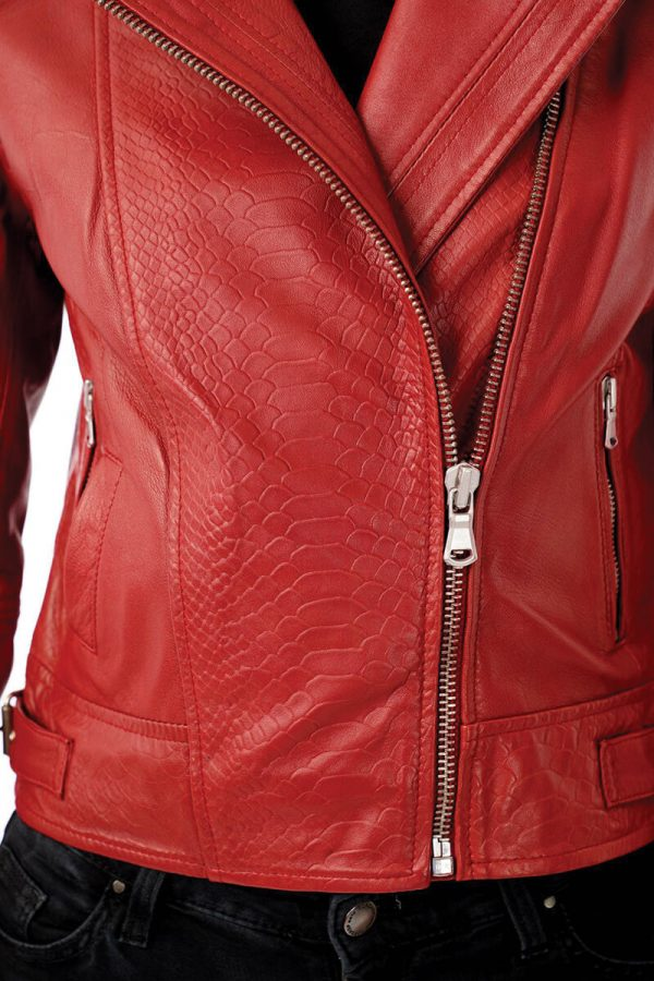Image shows a close up shot of the snake print/ mock croc texture on this red real leather jacket. You can see that the pattern is embossed into the leather to give it texture. You can also see the silver zip in this photo.