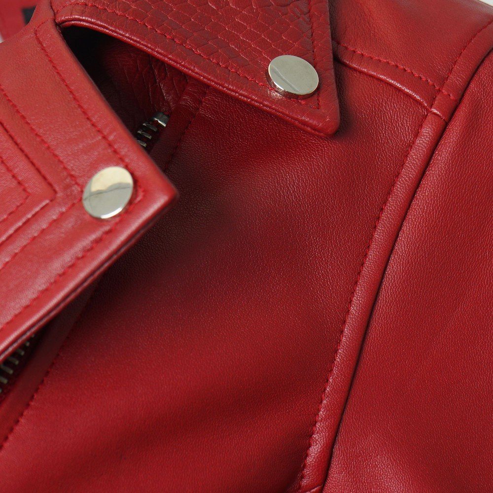This image shows a Barneys Originals Women's Real Leather Biker with Snake Print Detailing in Red. This image shows the collar of the jacket.