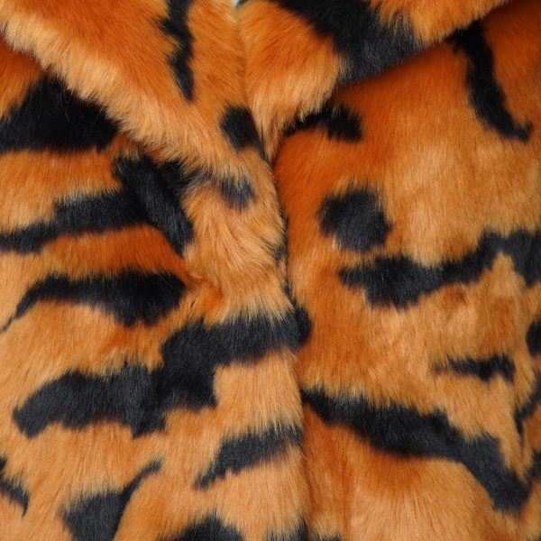 This image shows a Barneys Originals Long length Tiger Print Faux Fur Coat. This photo focuses on the collar of the jacket.
