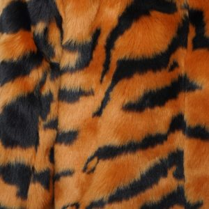This image shows a Barneys Originals Long length Tiger Print Faux Fur Coat. This photo focuses on the tiger print pattern of the jacket.