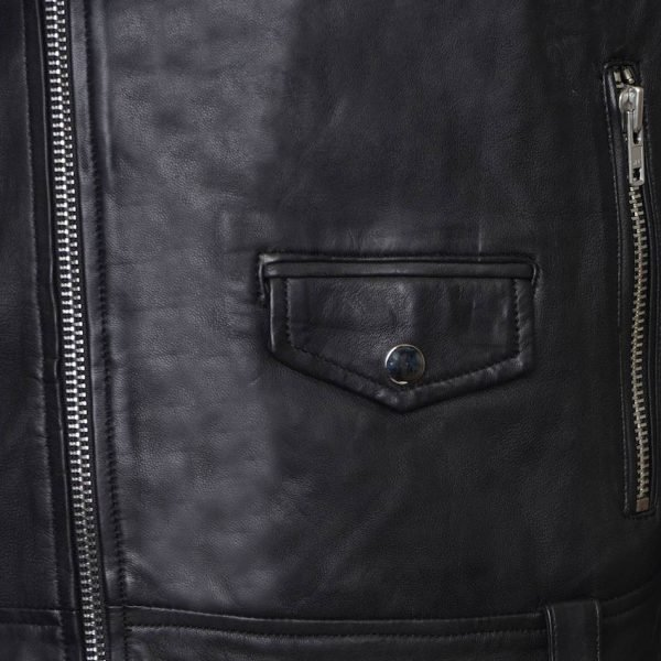 This image shows a Barneys Originals Men's Classic Real Leather Asymmetric Biker. This particular picture focuses on the button pocket of the jacket.