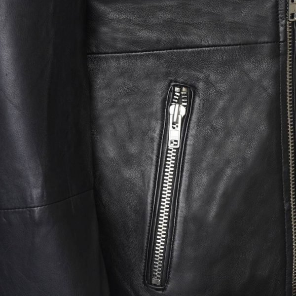 This image shows a Barneys Originals Men's Classic Real Leather Asymmetric Biker. This image focuses on the zipped pocket.