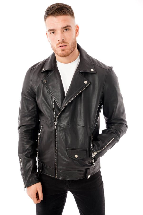 Image displays the men's real leather jacket as worn by a model with the zip pulled up halfway. This shows of the asymmetric zipline and shows have the lapels hang to the side when worn half open. You can also see silver pop studs on the lapels.