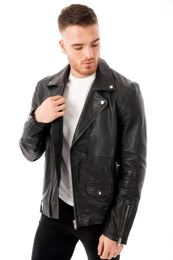 Image displays a model wearing the Barneys Originals real leather biker jacket for men. He has worn the jacket unzipped to show the way the jacket hangs on the body. Zips can be seen on the sleeves of the jacket.