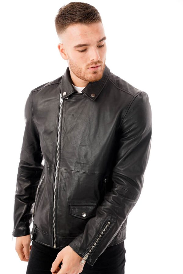Image displays the Barneys Originals real leather jacket as worn by a model from the front. The jacket is fully zipped up to display the asymmetric zipline.