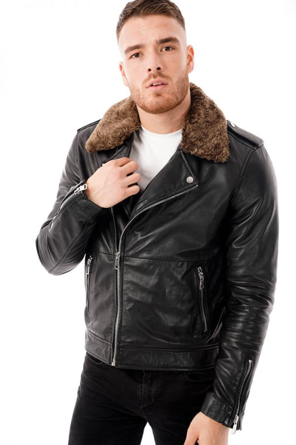 This Image shows a man's Barneys Originals biker jacket with a detachable faux fur hood worn by our model. In this image, the model has the jacket zipped up.