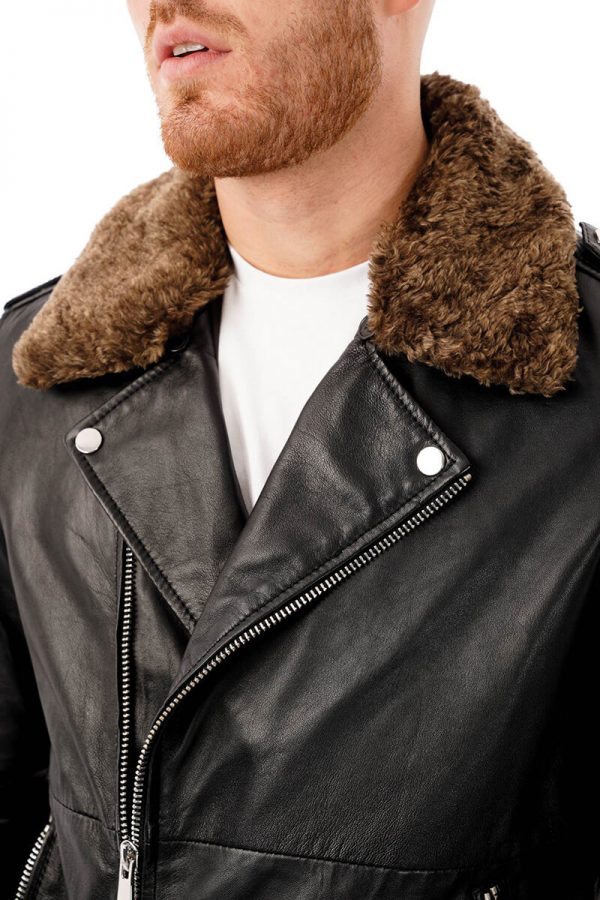 This Image shows a man's Barneys Originals biker jacket with a detachable faux fur hood worn by our model. This image focuses on the collar and chest of the jacket.