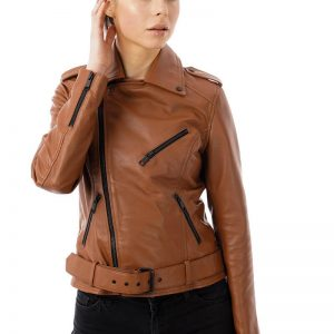 This image focused on a model wearing a Barneys Originals real leather jacket in a tan brown colour. You can clearly see the matte black trims across the jacket. This feature is on the main zip, scuff zips, 3 pocket zips and belt buckle.