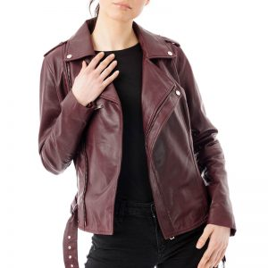 Image displays a model wearing the burgundy leather jacket open and unzipped. The waistbelt hangs down and the lapels fall to the side. The jacket has full length sleeves.