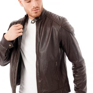 This image shows a Barneys Originals men's brown leather jacket being worn by our model. In this image, the model is wearing the jacket open.