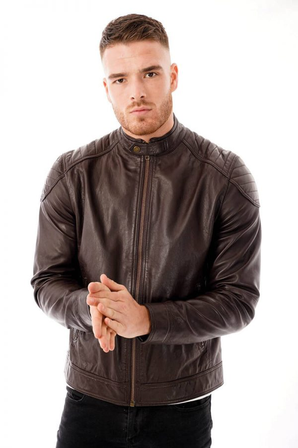 This image shows a Barneys Originals men's brown leather jacket being worn by our model. In this image the model has zipped the jacket to the top.