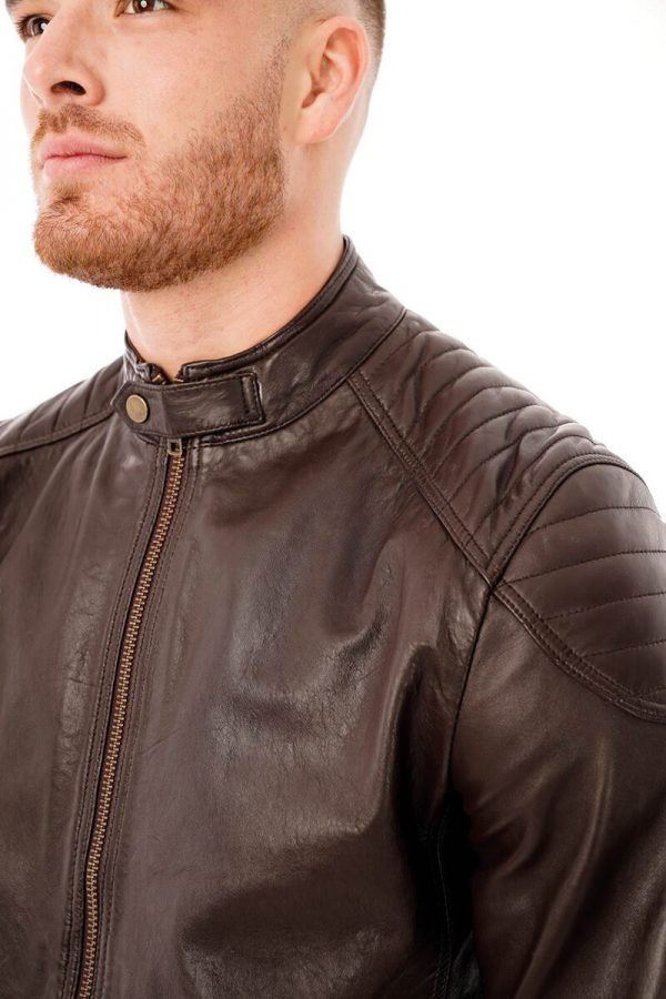 This image shows a Barneys Originals men's brown leather jacket being worn by our model. This image is focused on the collar and chest.