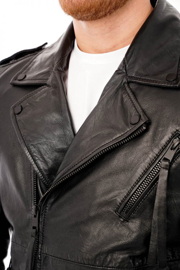 This image shows a men's barneys originals black biker jacket being worn by our model. This image focuses on the collar and chest of the jacket.